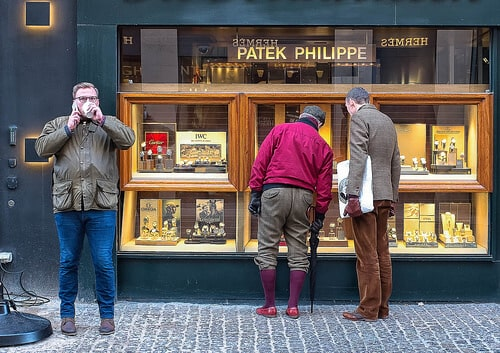 Men looking at Patek Philippe Store